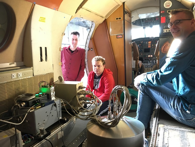 SRON engineers  Rob Wolfs (left), Jens Johansen (middle) and Geert Keizer (right) inside the Falcon aircraft during the installation of SPEX airborne. In the front the aluminum dome holding SPEX airborne and electronics boxes